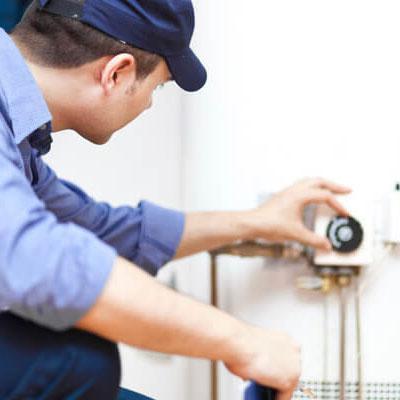 Tech Repairing Water Heater