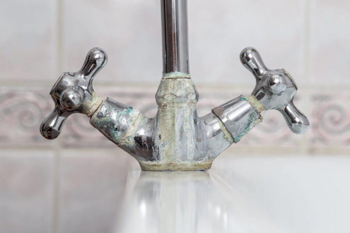 Hard water build up on faucet.