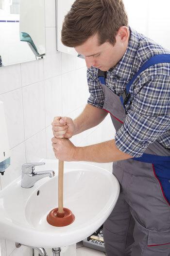 Plumber Unclogging Drain