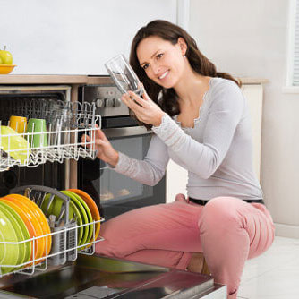 Woman Smelling Dishwasher Odor