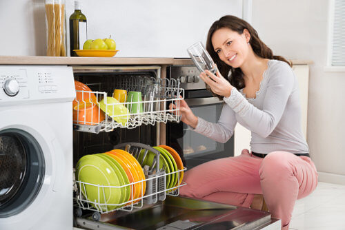 Woman Smelling Dishwasher Odor