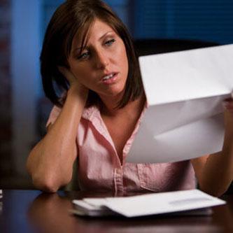Woman Reading Water Bill